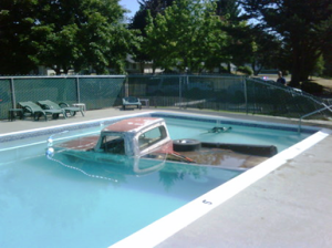 old pickup truck in swimming pool