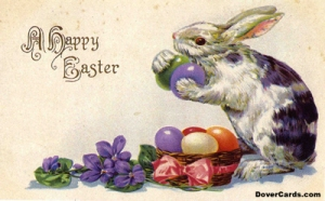 Easter rabbit with basket of colored eggs