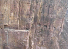 small road cut out of mountainside