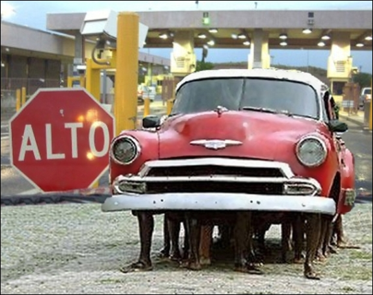 Red 1951 Chevy without tires